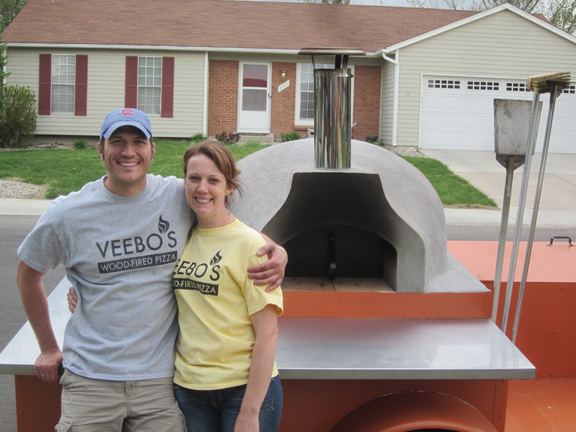 Ryan and Melissa Vyborny standing in front of the first pizza trailor.